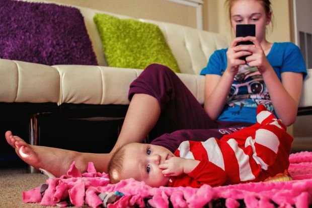 babysitter-on-phone-ignoring-baby